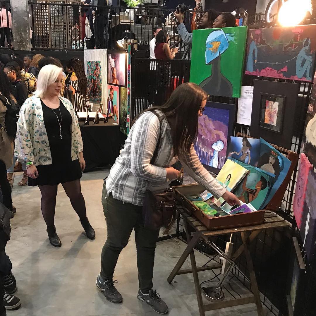 Photo of an art show where artist Hannah Day is showing her work in Atlanta Georgia.